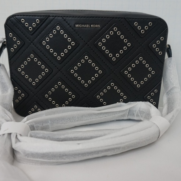 26abfba26ca8 Michael Kors Ginny Grommeted Leather Crossbody